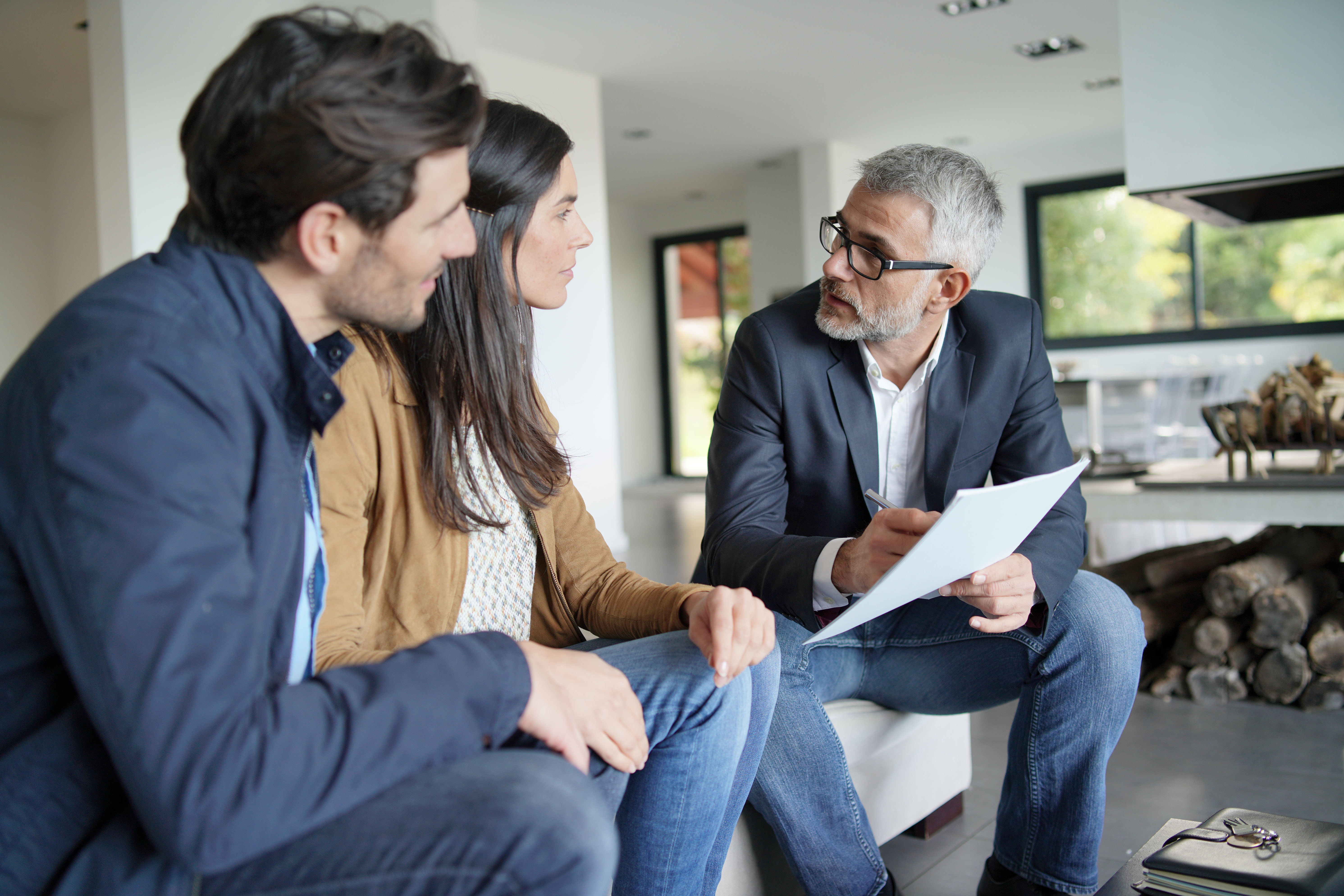 Couple talking with a financial advisor.