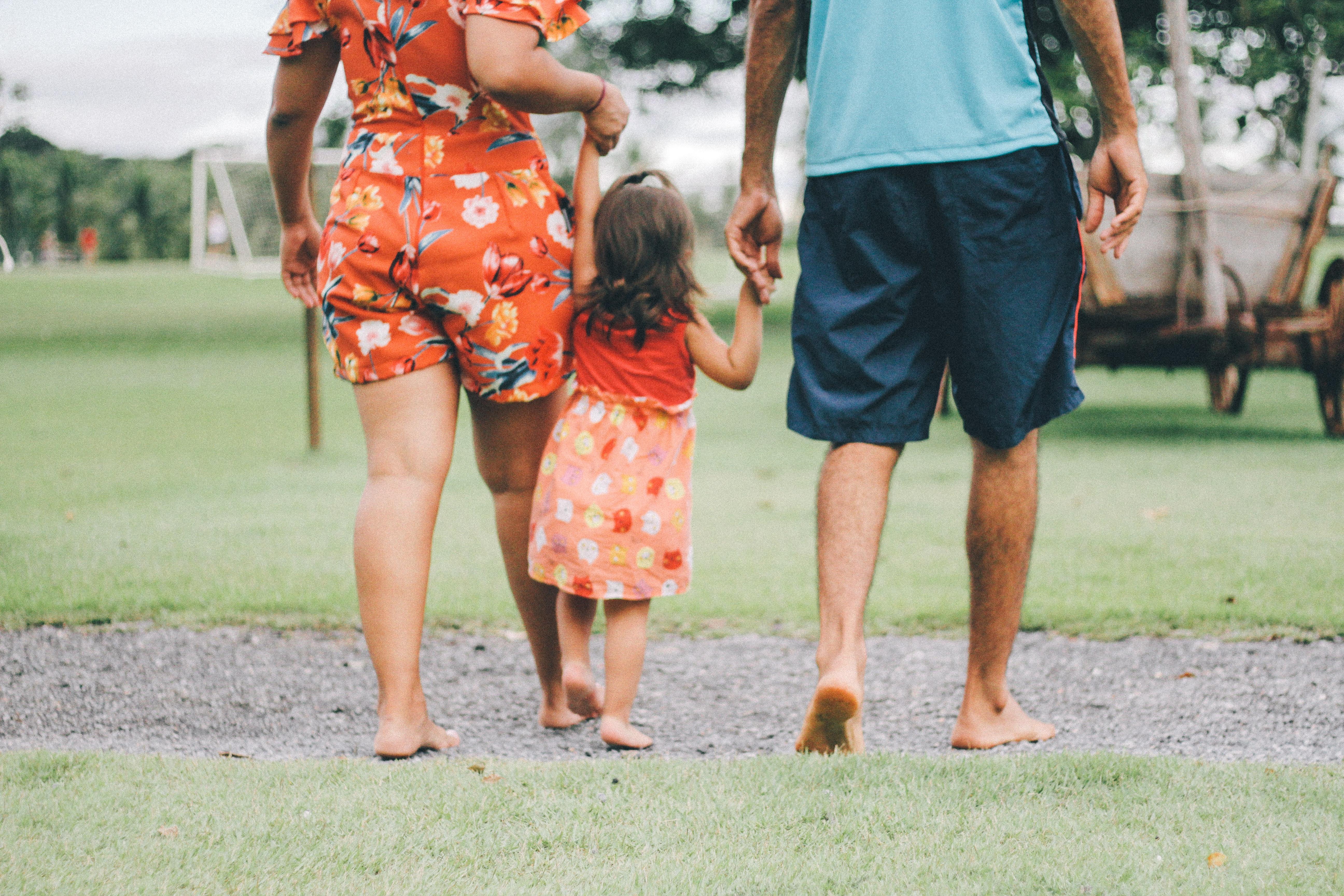 Family walking at a park.