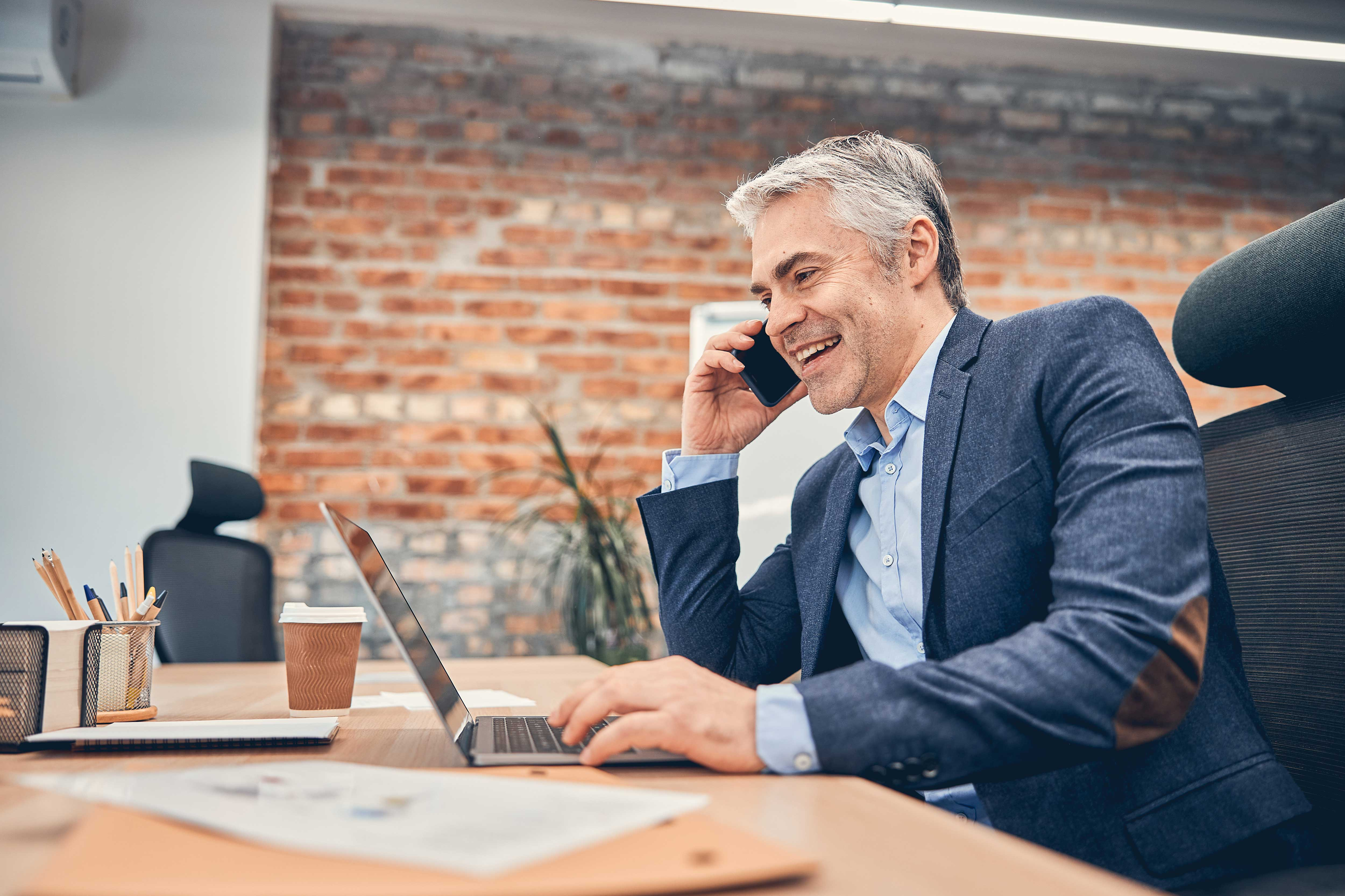 Middle aged businessman talking on the phone